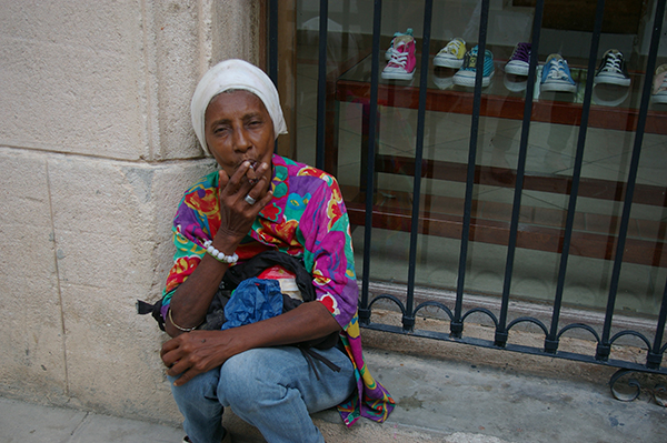A Cuban woman smoking cigar in Old Havana.