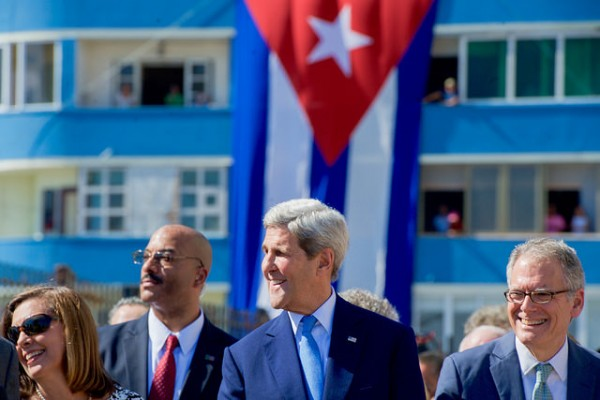"John Kerry Laughs as the Crowd Across the Street Yells ""Viva Cuba"" at End of Playing of Cuban National Anthem."